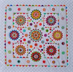 This beauty includes hand and machine piecing as well asappliqué and is assembled in 3 sections. The finished quilt measures 80 inches by 80 inches.