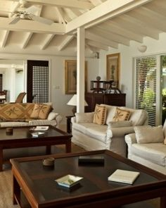 The British Colonial style living room opens to panoramic ocean views.
