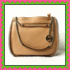 """Authentic Michael Kors Chain Leather Handbag % AUTHENTIC ✨ Gorgeous chain around soft leather large handbag from Michael Kors Color: Tan Length 14 1/2"""" Height 12 1/2"""" Width 4 1/2"""" Silver tone hardware. Zipper top closure. 5 pockets inside w/ lovely exterior MK charm NO TRADE PRICE FIRM‼️ Michael Kors Bags Shoulder Bags"""