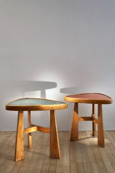 Charlotte Perriand,Wood and Stained Aluminum Doron Occasional Tables, 1947.