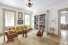 In the same room, midcentury seating contrasts with an 1870s chandelier.