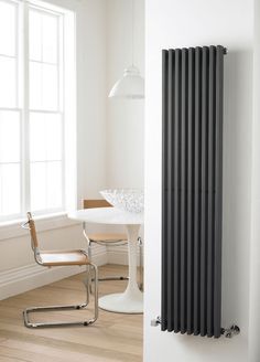 https://i.pinimg.com/236x/a0/03/52/a003526a3dc526ee664810f4e11f7b6b--vertical-radiators-designer-radiator.jpg