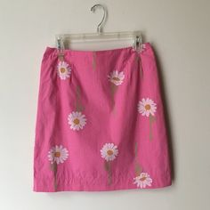 """Lilly Pulitzer Pink Daisy Stripped Skirt Hidden back zipper with hook and eye closure. Back pocket with button closure on right side. Waist 28"""" Hips 38"""" Length 20"""". Shell 100% Cotton. Fully lined. Gently used but in great condition!! Offers welcome! Lilly Pulitzer Skirts"""