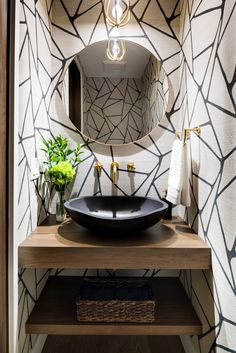 A powder room with unique textures of geometric patterns and a black stone basin. A powder room with unique textures of geometric patterns and a black stone basin. Powder Room Vanity, Powder Room Wallpaper, Powder Room Decor, Powder Room Design, Rustic Powder Room, Black Powder Room, Geometric Wallpaper Powder Room, Bold Wallpaper, Powder Room Mirrors
