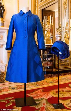 http://www.dailymail.co.uk/femail/article-3673776/The-Queen-s-iconic-outfits-display-Buckingham-Palace.html#ixzz4FOTQxk8A Follow us: @MailOnline on Twitter | DailyMail on Facebook  / The Queen's outfit for Princess Anne's wedding