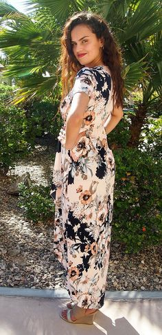 TheDance The Night AwayPink Floral Wrap Hi Low Maxi Dresswill be sweep you off your feet! Perfect for your next night out or weekend out on the town. Wovenpink fabric ( with an white, peach, brown, navy blue, and grey floral print ) parades down a surplice bodice, which gathers along the yoke and elasticized waist. A full maxi skirt with high low hemline ensures you found your new favorite dress! Cap sleeves finish off this fantastic dress. www.ledyzfashions.com #maxidress