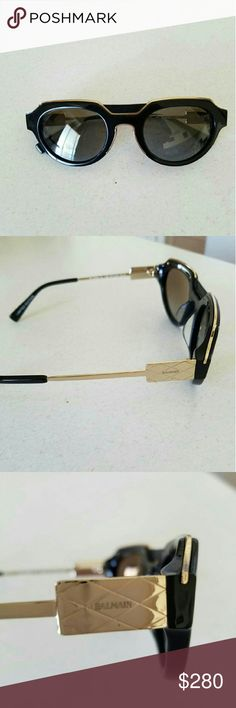 "Unisex Balmain sunglasses Gold and black acetate retro-frame sunglasses  Grey and matt gradient lenses  Leather insert on front  100% UV protection  Frame Width : 14,5cm / 6""  Frame Height : 4,5cm / 2""  Made in France  $150 or best offer Balmain Accessories Glasses"