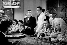 Casablanca (1942) photo from the film where Rick (Humphrey Bogart) helps an uncredited actor (Barry Norton?) win at Roulette so he'll win enough money so his wife and he can afford to get out of Casablanca.