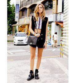 Chiara Ferragni of The Blonde Salad On Chiara: Illesteva sunglasses; Clover Canyon top; Zara shorts; Chanel bag; Balenciaga boots.