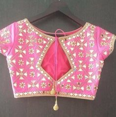 Check out the latest saree blouse designs for back and front for festive seasons like Durga puja, karwa chauth and Diwali. Also, see the latest choli designs and blouses for Navratri dandiya and Garba dance. Blouse Back Neck Designs, Fancy Blouse Designs, Latest Blouse Designs, Mirror Work Saree Blouse, Mirror Work Blouse Design, Boat Neck Saree Blouse, Lehenga Blouse, Sari Design, Stylish Blouse Design