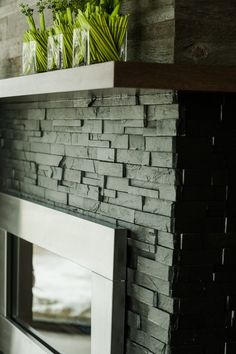 Fireplace designed and manufactured by Woodecor photo by Myles Wilson. Featuring ErthCOVERINGS Springwood Black 3D slate panels, finished with colour enhancing sealer