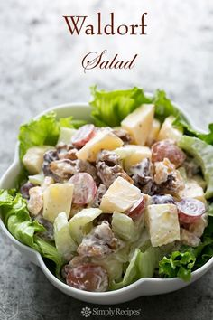 First presented at the Waldorf Astoria Hotel in this all-American Waldorf salad recipe includes chopped apples, celery, grapes, and toasted walnuts in a mayonnaise dressing. Waldorf Salat, Cuisine Diverse, Def Not, Cooking Recipes, Healthy Recipes, Simply Recipes, Chicken Salad Recipes, Celery Recipes, Apple Salad Recipes