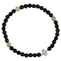 we die for an armful of these onyx beaded bracelets; pair this hamsa with an evil eye and your favorite watch.