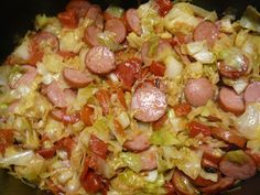 Kielbasa and Cabbage - what to do with leftover grilled hot dogs and lotsa sliced cabbage?? :D (this recipe served as a base idea - we used sliced red and green cabbage, some bell pepper and onion, garlic and salt and pepper...and our leftover hot dogs ;)