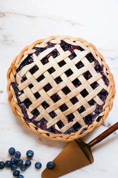 Flavored with orange zest and cardamom, this pie is a great use for summer's plump, juicy blueberries. As far as pie fillings go, this one is pretty easy—no pitting, peeling or slicing required.