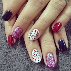 Red and navy nails with dots and glitter