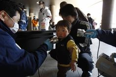 Fukushima: health disaster or PR fail?(japan times,sep7,2013)  photo:Fears for the future: A child is screened for radiation shortly after the accident at Fukushima No.1 nuclear power plant in 2011. Fukushima Medical School continues to monitor some 360,000 under-18s for signs of cancer. | AP  No Nukes !   Save Children !