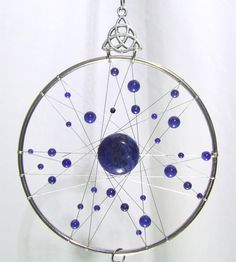 Check out this item in my Etsy shop https://www.etsy.com/uk/listing/288962379/small-lapis-lazuli-dream-catcher-wall