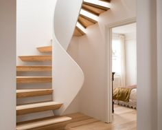 Twisted staircase features in renovation by 51 Architecture