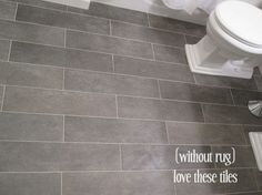 Bathroom tile--tiles: Crossville Ceramic Co from The Great Indoors, planks (color: Lead) floor grout: Lowe's (warm gray) Upstairs Bathrooms, Downstairs Bathroom, Bathroom Renos, Grey Bathrooms, Small Bathroom, Bathroom Ideas, Bathroom Gray, Bathroom Colors, Bathroom Remodeling