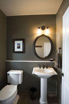 Powder room. Half bath. Guest bath. White pedestal sink. Oil rubbed bronze fixtures. Building a new home blog.