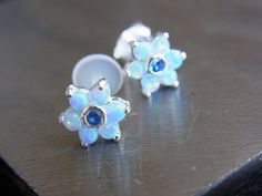 Ocean Blue Opal gems flower bio flexible labret / helix / cartilage earring (1pc) on Etsy, $21.95