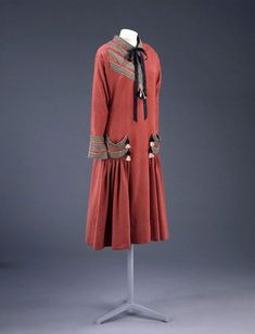 Day dress  Paul Poiret (1879-1944)  1924  Paris  Fine flecked worsted, trimmed with rayon braid and tassels, machine stitched and hand finished