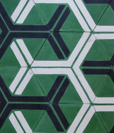 Handmade in Morocco from locally sourced materials using a traditional, 150-year-old technique, these encaustic cement tiles from Popham Design are durable and non-toxic. We love the bright kelly green and bold hexagonal patterning.