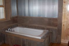 Barn lumber bath, This bathroom used to be a 10x10 bedroom.  It was remodeled to be a bathroom.  The barn lumber on the walls came off of a barn on the farm where we live.  The barn lumber goes up to a chair rail made out of tobacco sticks (this is Kentucky after all) and then corrugated tin goes up to the ceiling.  Their is also corrugated tin on the ceiling., Bathrooms Design