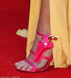Pulling the trend trigger: Her $849Joyce Echols heels come with a tiny holster and a decorative gold pistrol
