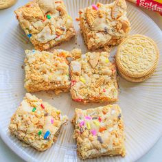 Golden Oreo Cake Batter Blondies - vanilla, funfetti, cookies n cream, and sprinkles all in one! They are so easy to make and impossible not to gobble up!