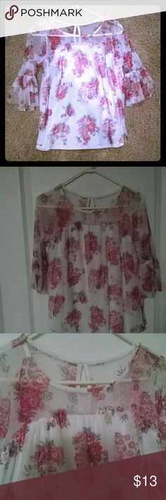 A lace white floral top White lace with floral prints, three quarter sleeve ,  loose fit , arms are not to tight , very pretty with denims , has pretty ruffle by the sleeve, worn twice No Boundaries Tops Blouses