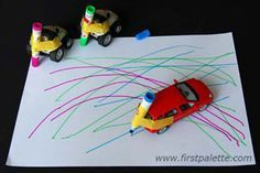 """Pintar com """"carros""""... Zooming pens: Fasten colored pens to cars and let your child zoom away with colorful lines and designs"""