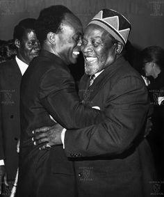 Osagyefo Dr Kwame Nkrumah hugs Mzee Jomo Kenyatta at Nairobi, Kenya. Circa 1964.