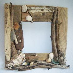 Hey, I found this really awesome Etsy listing at http://www.etsy.com/listing/106748155/handmade-driftwood-and-shell-mirror-30cm
