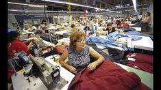 """Paulina Botelho sews a parka lining to a shell at the Canada Goose factory, where she's worked since The """"Made in Canada"""" firm has another large factory in Winnipeg and directly employs nearly people. Toronto Star, Fair Trade Fashion, Work Shirts, Kids Wear, Blouses For Women, Parka, Work Wear, Raincoat, How To Make"""