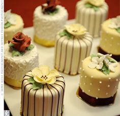 mini cakes- I think they would be more bridal shower appropriate, or perhaps groom cake. I think you would want the traditionallly large cake for the photo op, however!