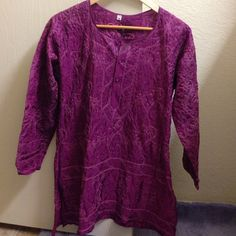 Silk embroidered tunic Purple tunic with heavy embroidery, full sleeves. 100% silk. Never worn, in new condition. Size 38, fits true S/4. Tops Tunics
