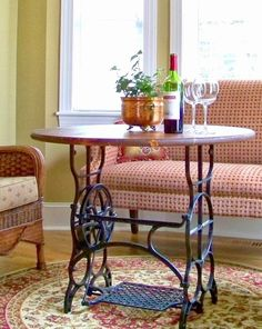 Cozy Little House: Upcycled Treasures an old sewing machine treadle base as a table