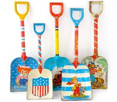 Tin Sand Shovels...loved the Tin Sand Pail/Shovel sets when I was growing up. Unfortunately most of them are rusty now.