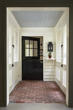dutch door into kitchen in contrasting color and painted ceiling~ neat ideas. Wishing the mudroom had brick floors!
