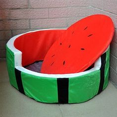 This comfy watermelon nook/bed for your pet (that they hopefully won't chew up).