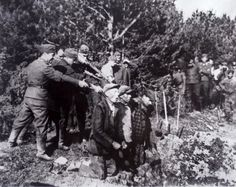 Germans Executing Jews near Kovno, Russia by  Unknown Artist