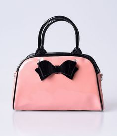 Wherever Lola goes, follow fabulously! A gleaming retro pink rockabilly bag from Hell Bunny, the Lola Bowling Bag is a pearlized PU patent purse with black contrast and a darling bow over the front. Self standing on a base with four metal feel, Lola has a