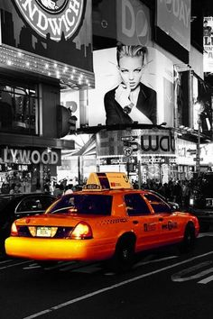 Ride in a yellow taxi in NYC.