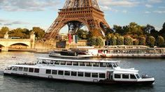 River Cruise Ship sailing by the Eiffel Tower in Paris, France - Avoya Travel Article: '2014 Cruises to Book Early & Get Best Bargains For'