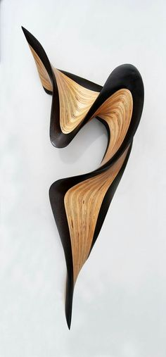 Wenge Jive by Kerry Vesper. This wood sculpture ripples across the wall with a flourish. The artist hand cuts layers of Baltic birch and *wenge wood*, then meticulously stacks and glues them together before carving and sanding them into the final form. Abstract Sculpture, Wood Sculpture, Modern Wall Sculptures, Contemporary Sculpture, Organic Sculpture, Instalation Art, 3d Studio, Organic Shapes, Organic Art