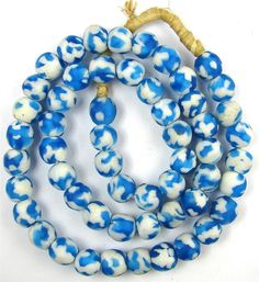 RARE Aqua White Recycled Glass KROBO Ghana African Trade Beads 21 Inches    THIS IS A NICE WELL MATCHED STRAND OF AQUA BLUE AND WHITE COLORED GHANA KROBO RECYCLED POWDER GLASS AFRICAN TRADE BEADS. These beads were handmade in Africa. This is an unusual color style for this type of beads and would be great for bead designers to use in their jewelery.