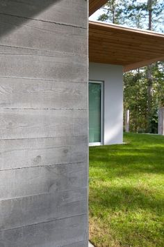 Concrete House Exterior: They used wood plank forms and it left an imprint on the concrete exterior. I wonder if the concrete could then be stained and sealed to look more like fresh lumber. Interesting idea.