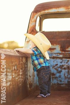 Cute little cowboy! Would be great to take a pic each year in the back of the truck to show how this little buckaroo changes!